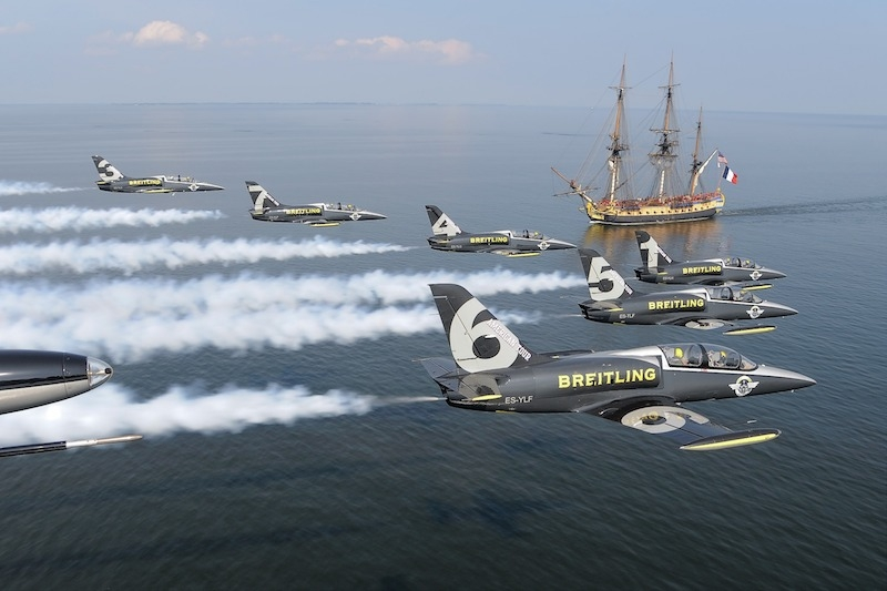 Six L-39C aircraft of the Brietling Jet Team pass over the replica of the 18th-century French ship Hermione, the ship that brought Marquis de Lafayette to the United States in 1780, as the ship sails up the Patuxent River to visit Annapolis, Md.,June 13, 2015. The Brietling Jet Team are currently on their first tour of the USA and the Hermione is on its first visit to port along the East Coast after having sailed from France. (Photo © 2015 Greg L. Davis/Breitling Jet Team)